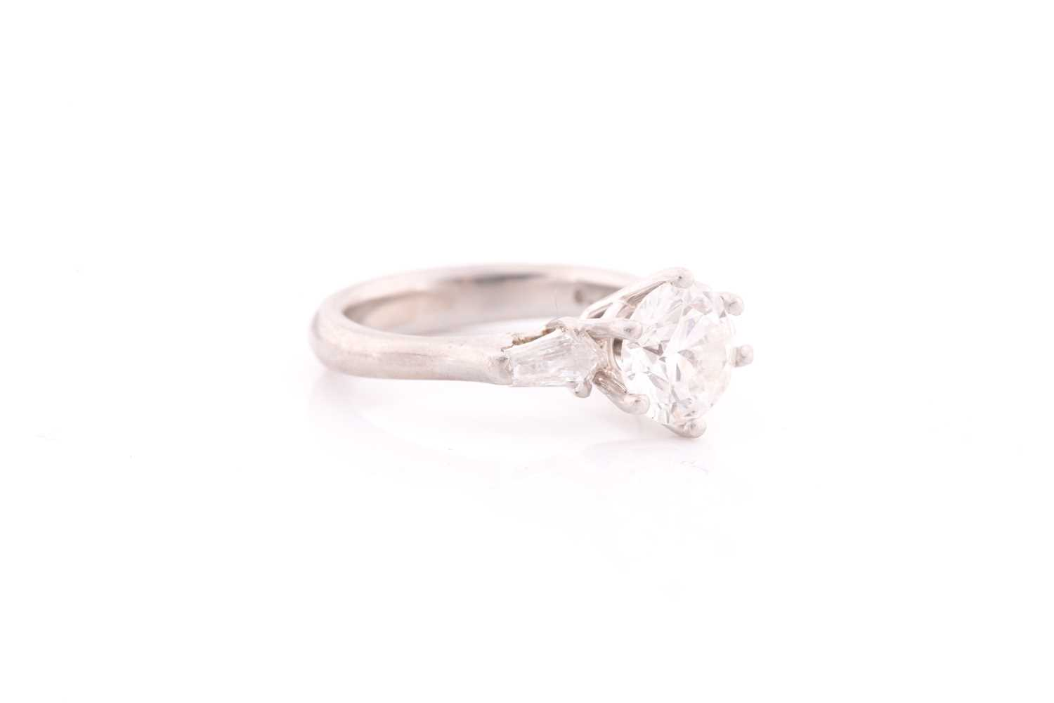 A platinum and diamond ring, set with a round brilliant-cut diamond of approximately 1.50 carats, - Image 4 of 4