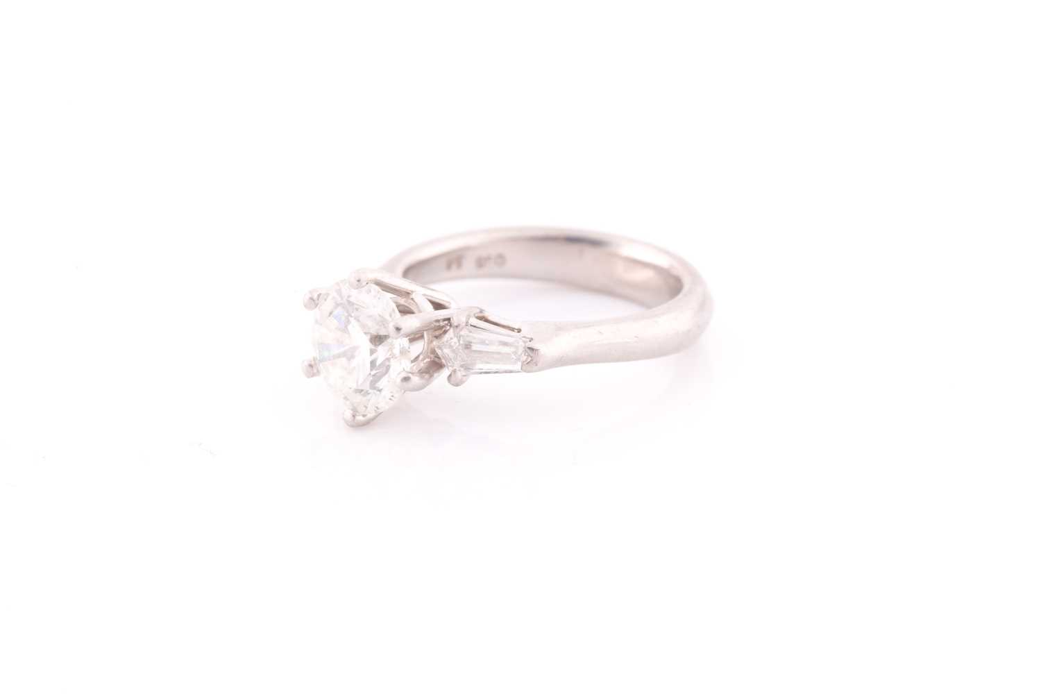 A platinum and diamond ring, set with a round brilliant-cut diamond of approximately 1.50 carats, - Image 3 of 4