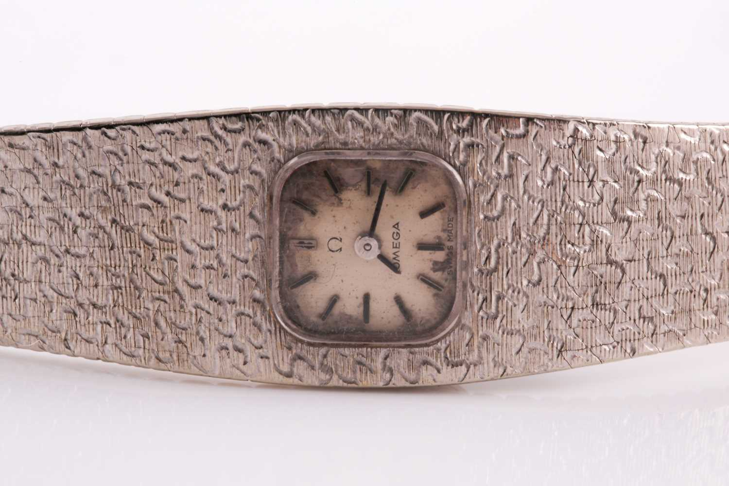 An 18ct white gold ladies Omega cocktail watch, the small baton dial inset into an articulated strap - Image 3 of 5