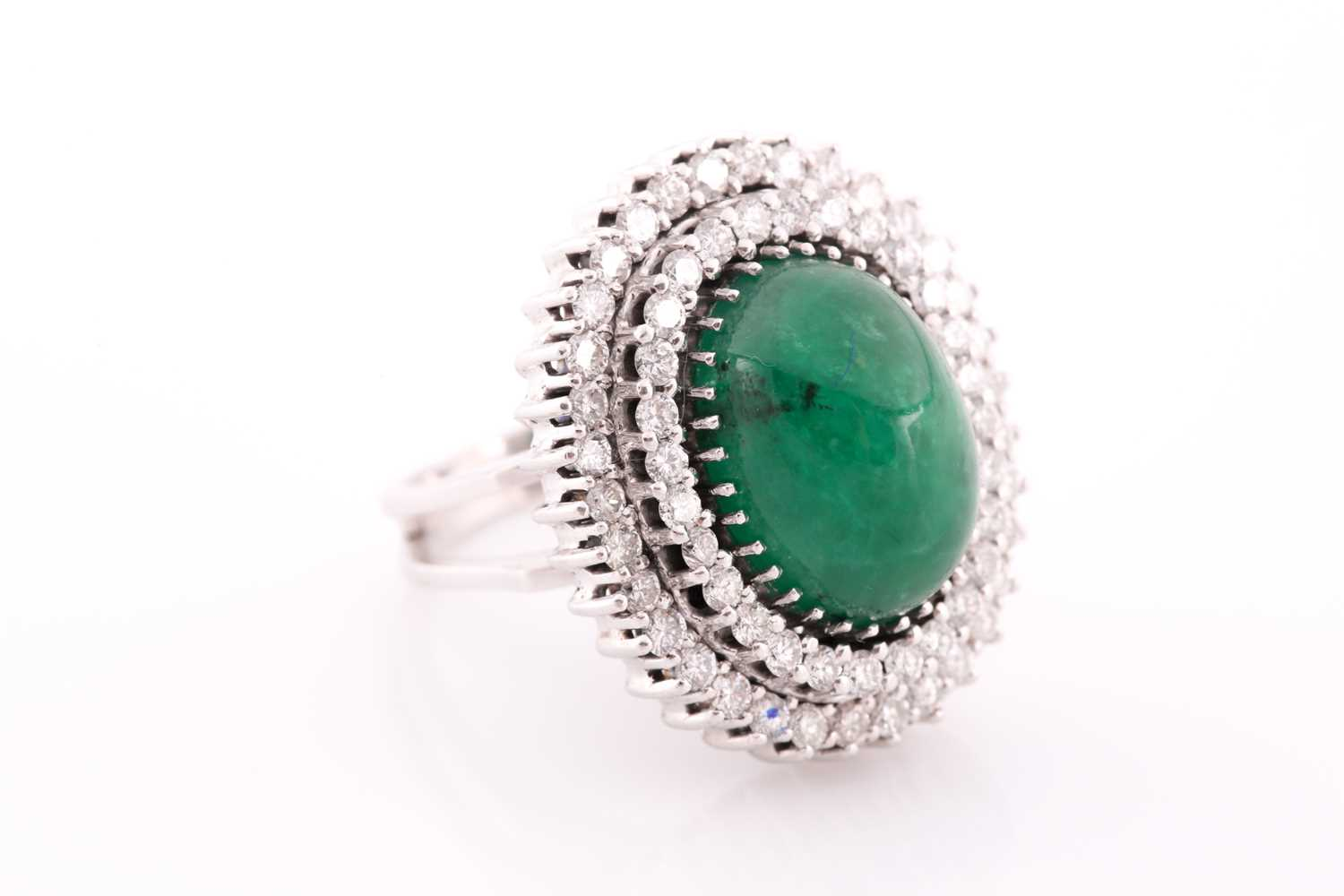 A diamond and emerald cocktail ring, circa 1960s, centred with an oval cabochon emerald, measuring - Image 3 of 6