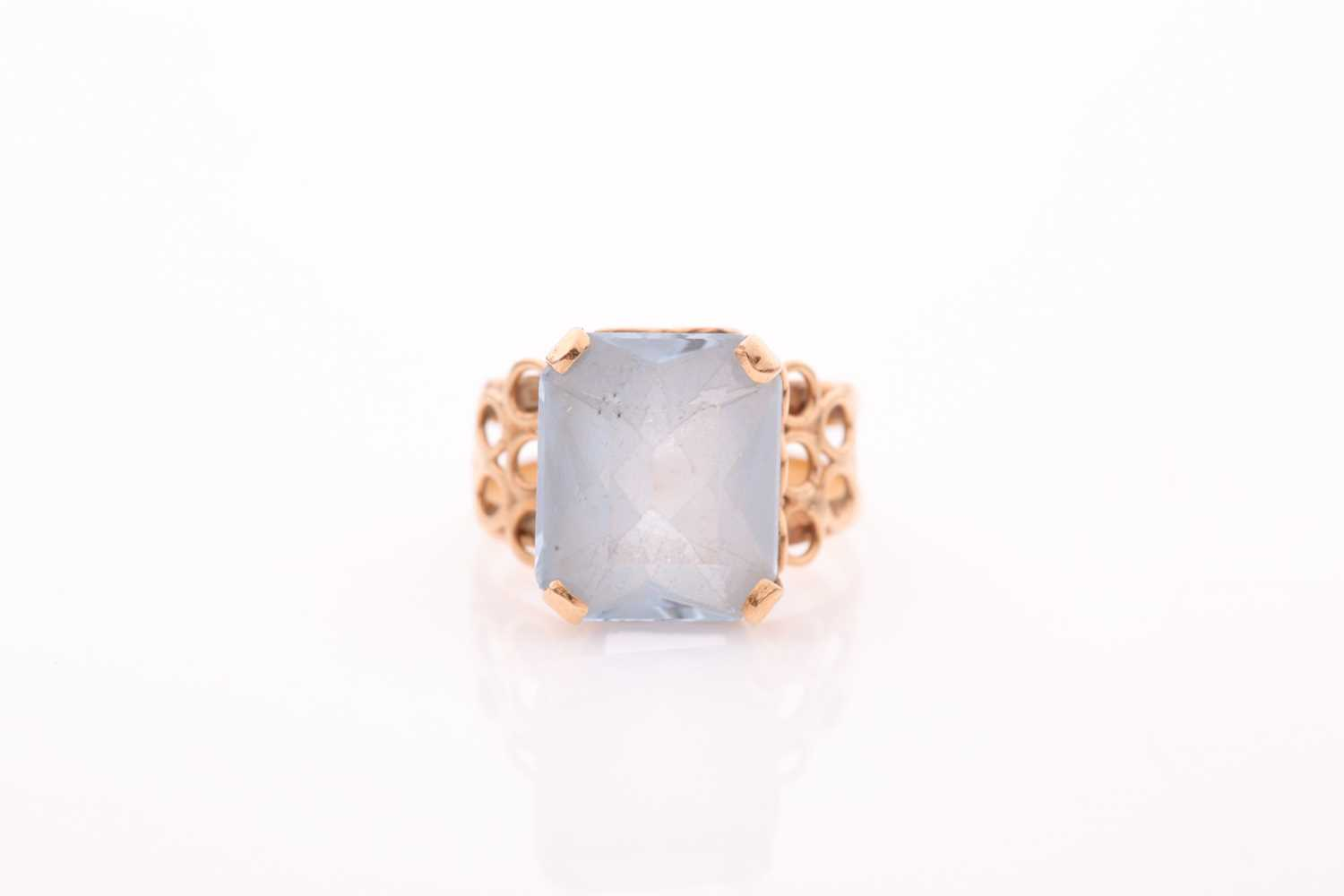 A single stone aquamarine dress ring, the rectangular mixed cut aquamarine in four claw mount to a