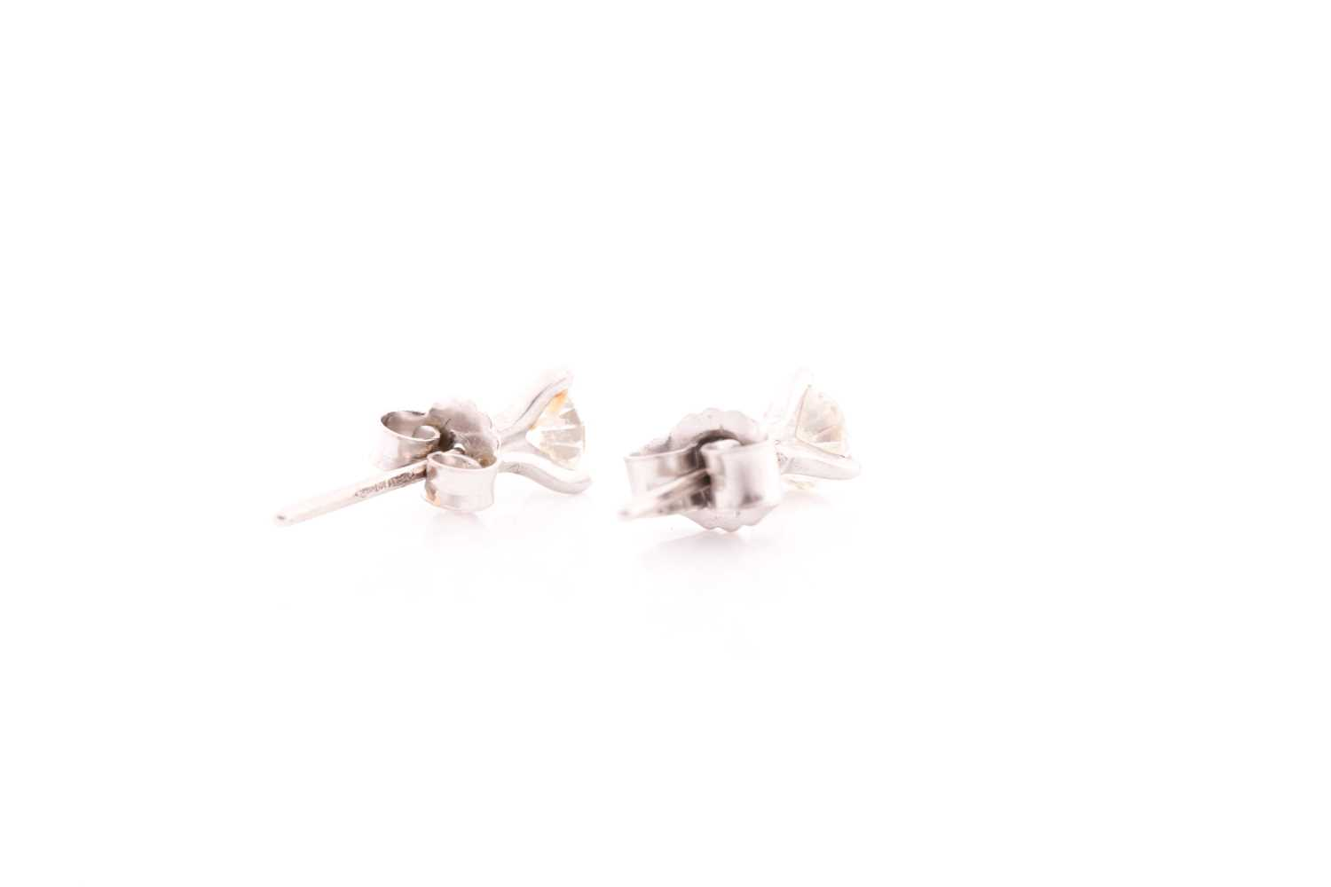 A pair of solitaire diamond stud earrings, set with round brilliant-cut diamonds of approximately - Image 3 of 3
