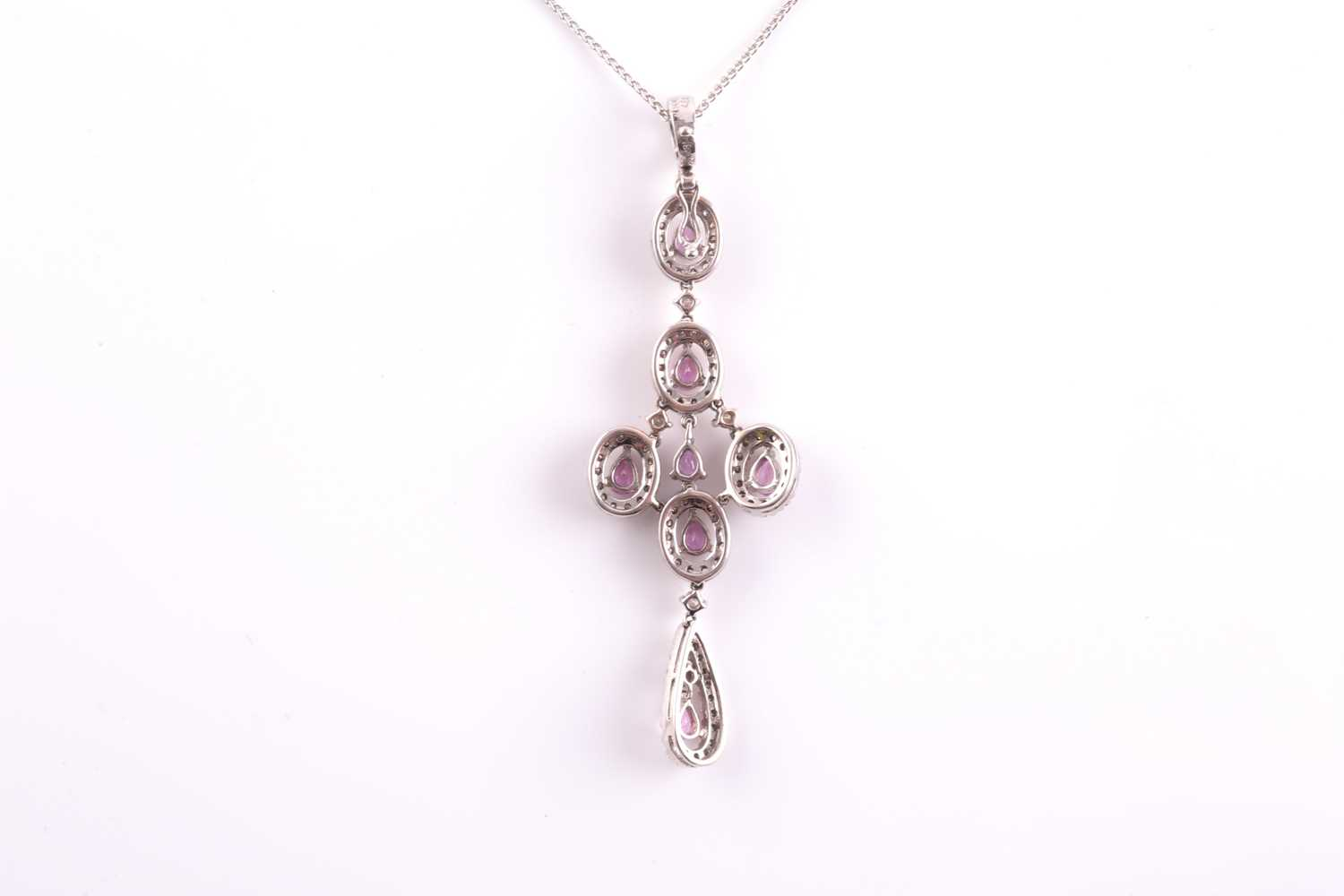 An 18ct white gold, diamond, and pink sapphire quatrefoil drop pendant necklace, the cross design - Image 2 of 4