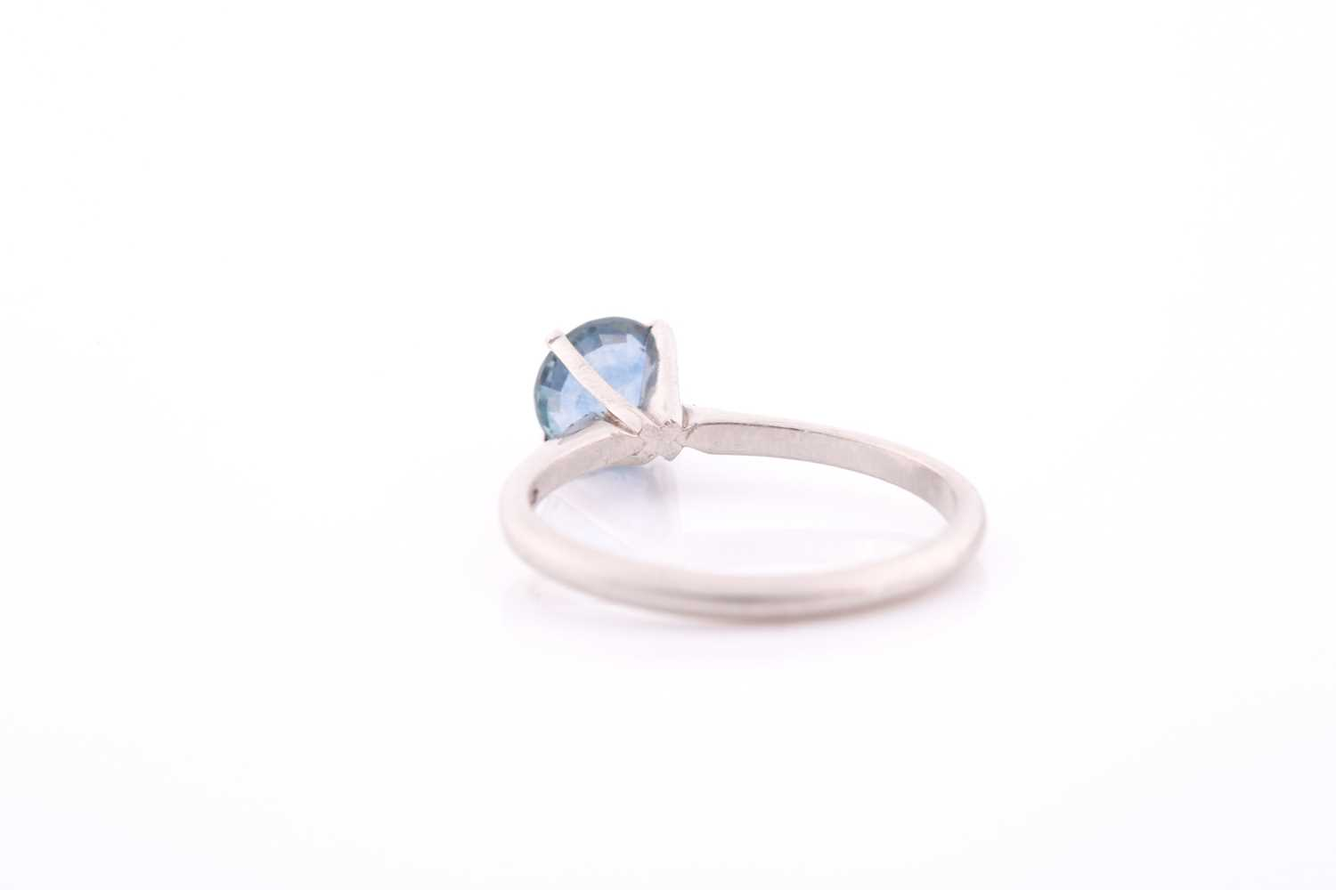 A platinum and solitaire sapphire ring, set with a mixed round-cut blue sapphire of approximately - Image 3 of 4