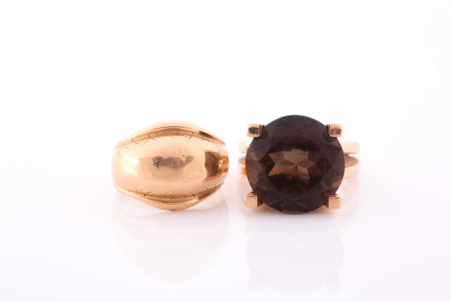 A 14ct yellow gold and smoky quartz ring, the stylised seventies-style mount set with a mixed