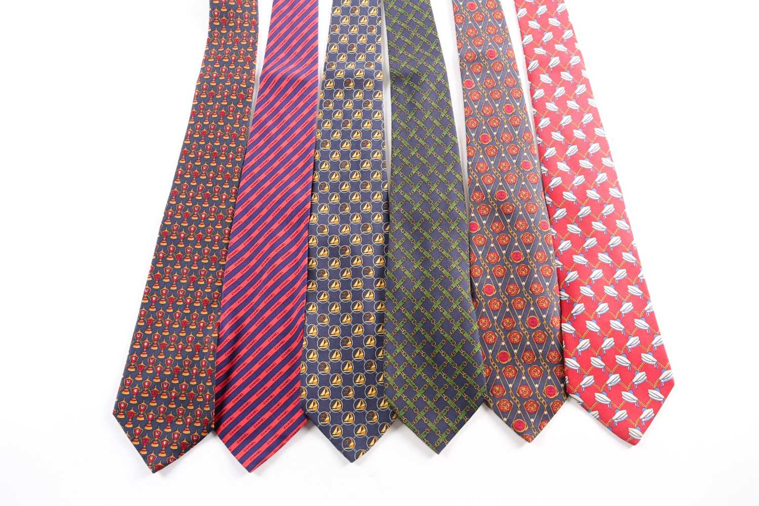 A group of seven Chanel ties, in various designs and colours. (7)