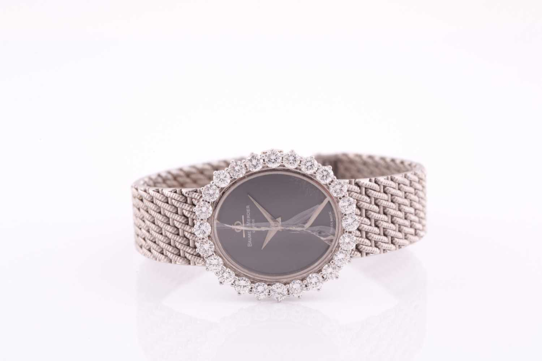A white metal ladies Baume and Mercier wristwatch, the bezel set with round brilliant-cut diamonds