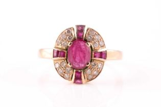 A ruby and diamond cluster ring, the central mixed oval cut ruby with a cruciform plaque of