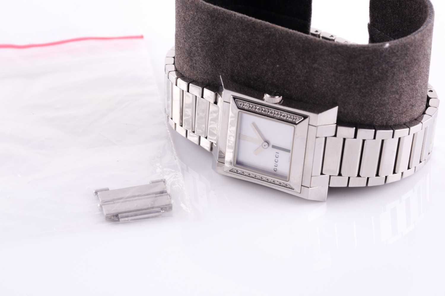 A ladies stainless steel watch by Gucci, with mother-of-pearl square dial, small diamonds set to - Image 6 of 10