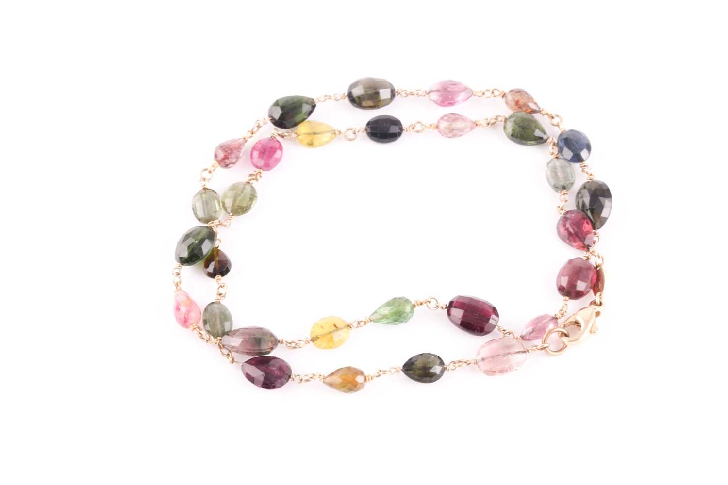 A 14ct yellow gold and varicoloured tourmaline necklace, comprised of briollete-cut pear, oval, - Image 3 of 4