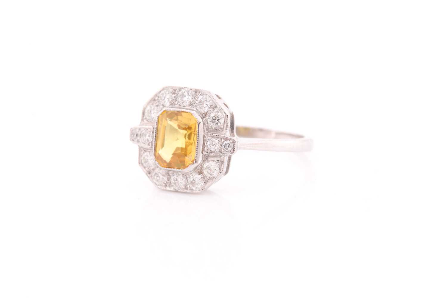 A platinum, diamond, and sapphire ring, set with an emerald-cut sapphire of approximately 1.50 - Image 2 of 4