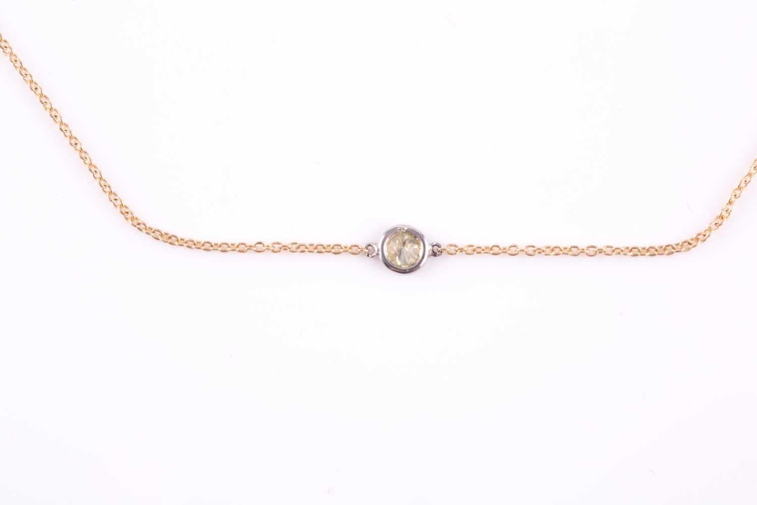 An 18ct yellow gold and diamond necklace, the chain set with a collet-mounted round brilliant-cut - Image 2 of 3