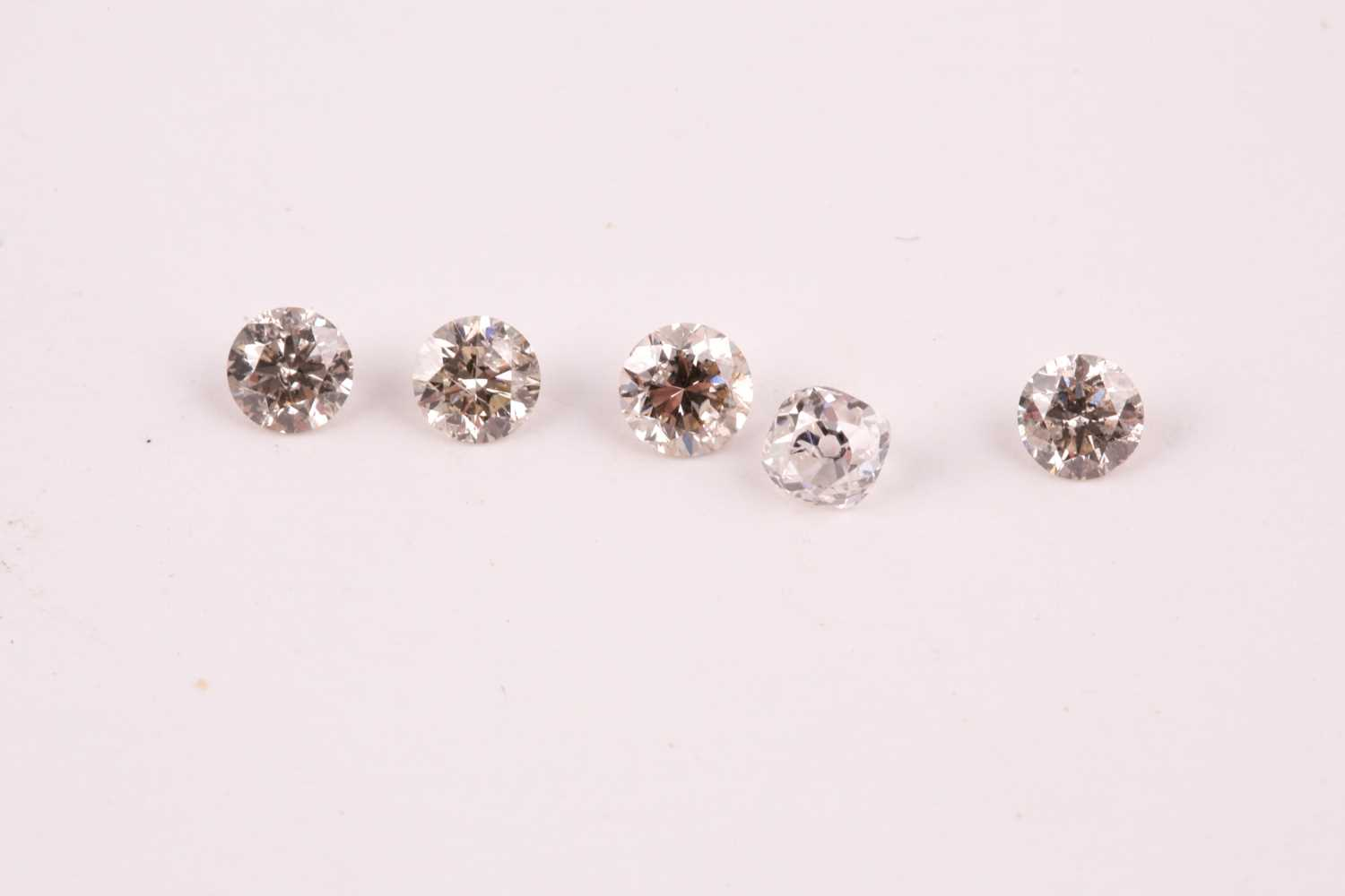 A group of five round brilliant-cut diamonds, showing slight colour, approximately 1.12 carats