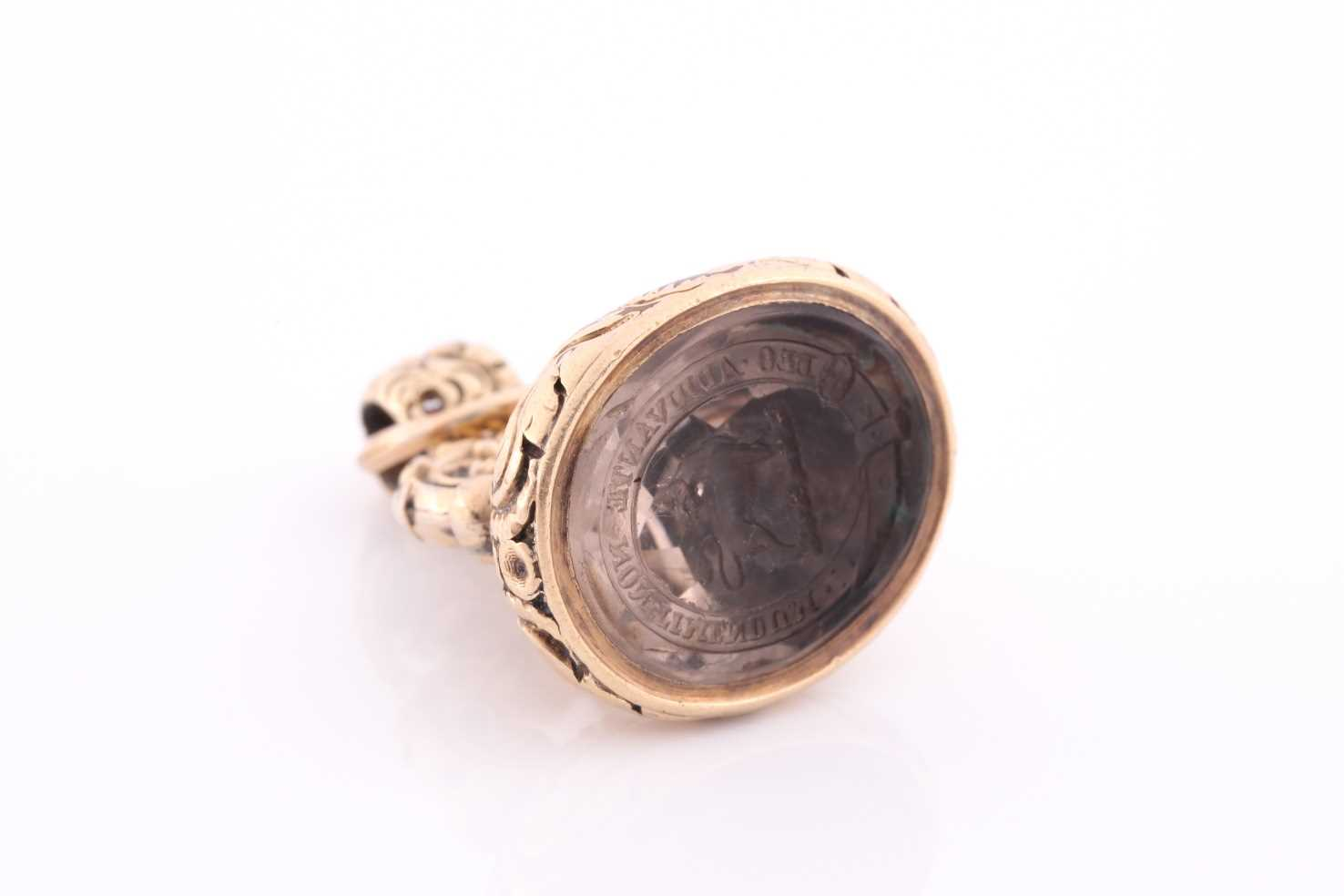 An antique yellow gold fob pendant with intaglio engraved smoky quartz inset, engraved with a coat - Image 4 of 5