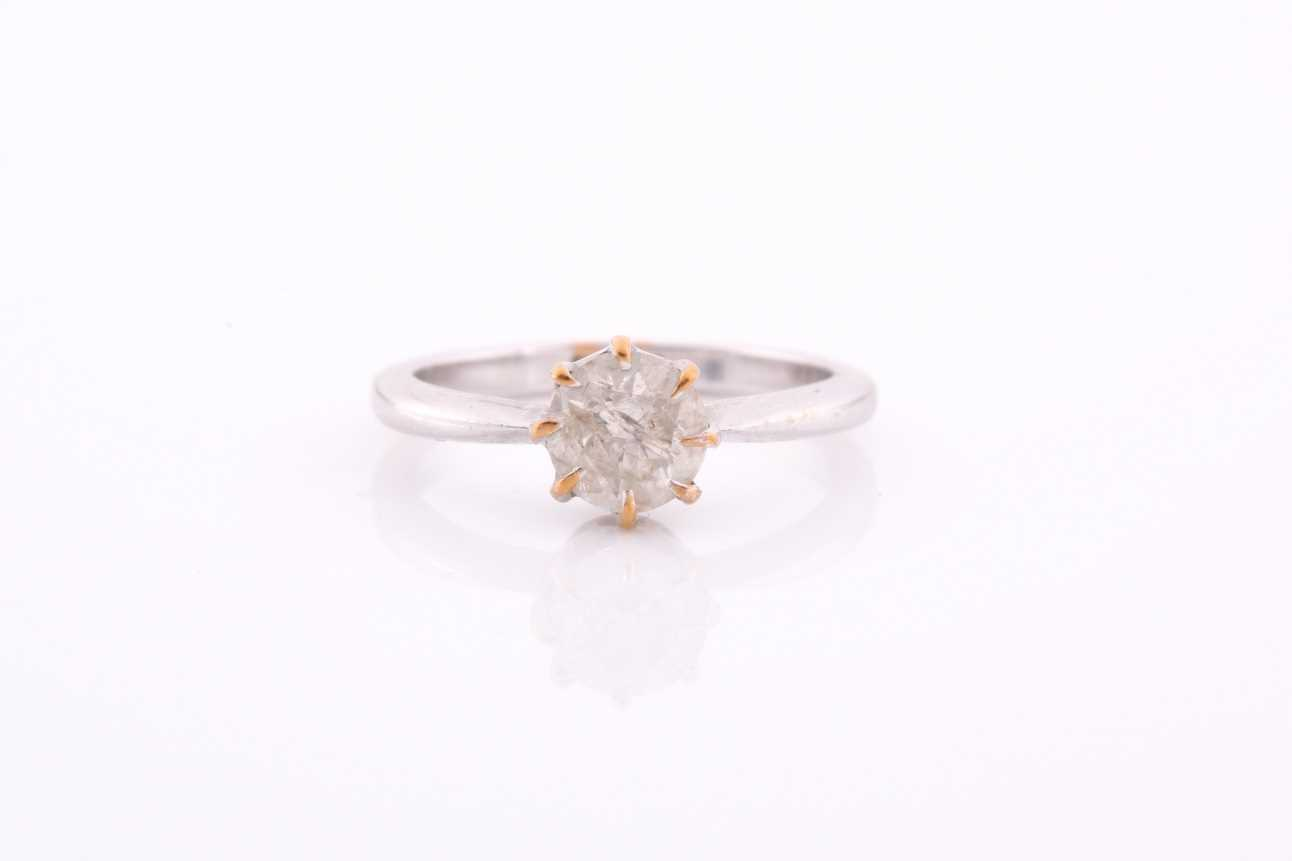 An 18ct white gold and solitaire diamond ring, set with a round-cut diamond of approximately 0.80