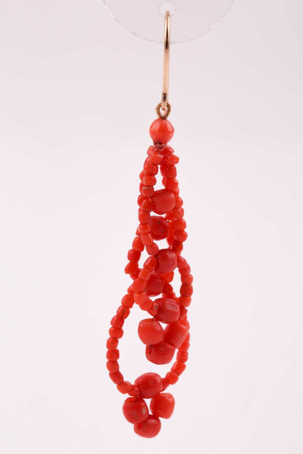 A pair of yellow metal and coral beaded earrings, the coral beads strung into two strands, - Image 2 of 4
