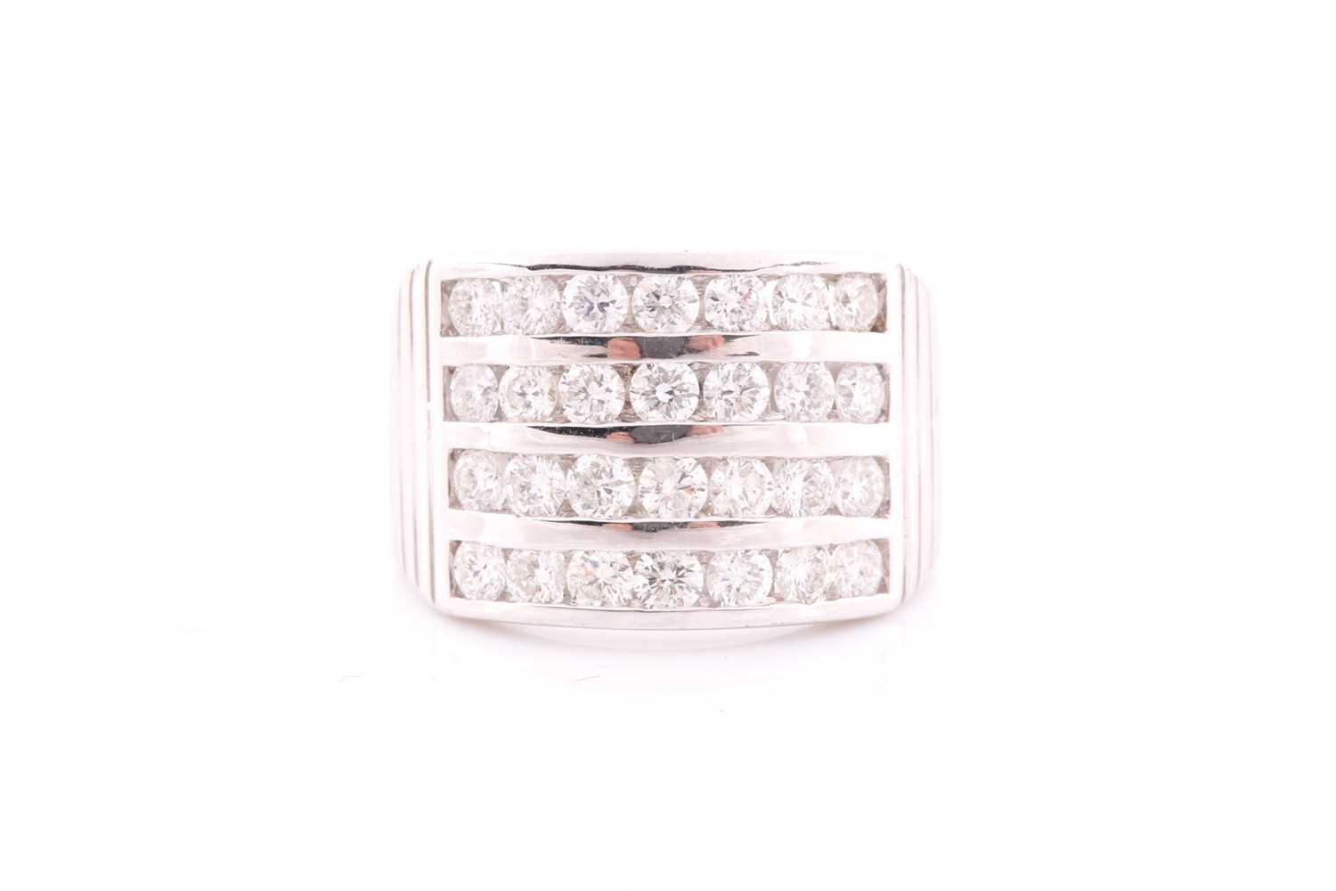 A diamond band ring, channel-set with four rows of round brilliant-cut diamonds of approximately 2.
