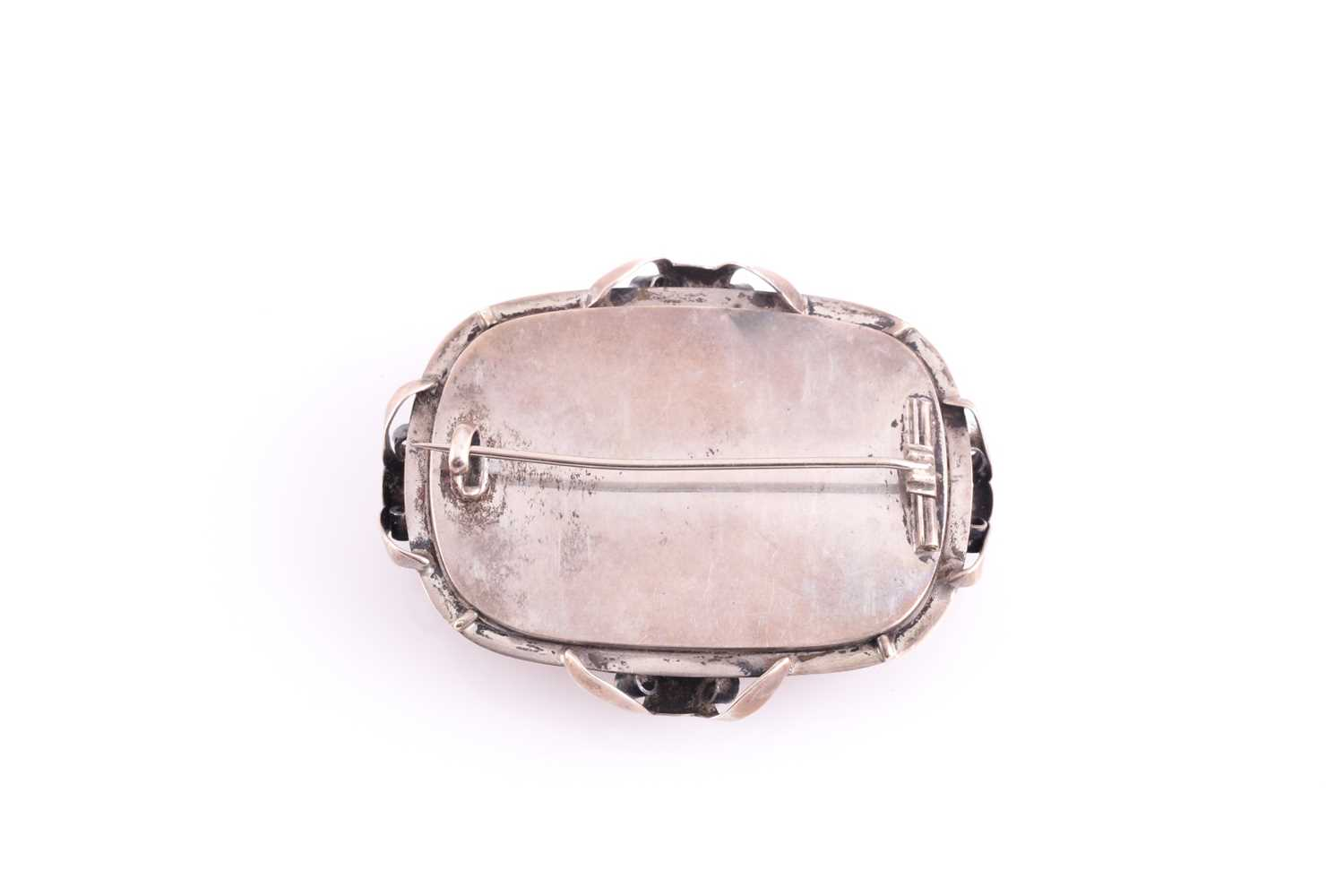 An Art Nouveau silver and amber brooch, the large rectangular single stone amber plaque withing an - Image 3 of 3
