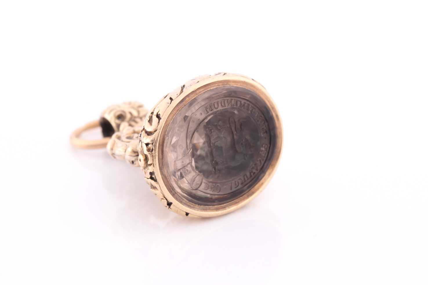 An antique yellow gold fob pendant with intaglio engraved smoky quartz inset, engraved with a coat - Image 3 of 5