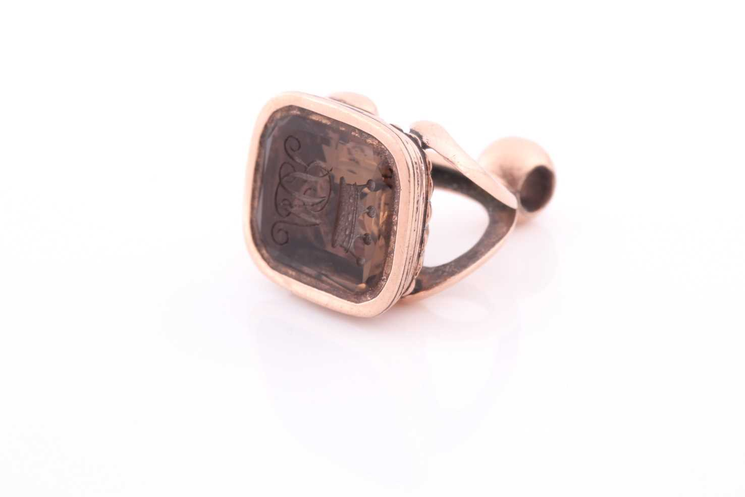 A yellow metal and quartz fob pendant, intaglio engraved with initials MR, unmarked (tests as rose