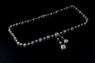 An impressive antique collet-set diamond lavliere necklace, suspended with two old mine cut