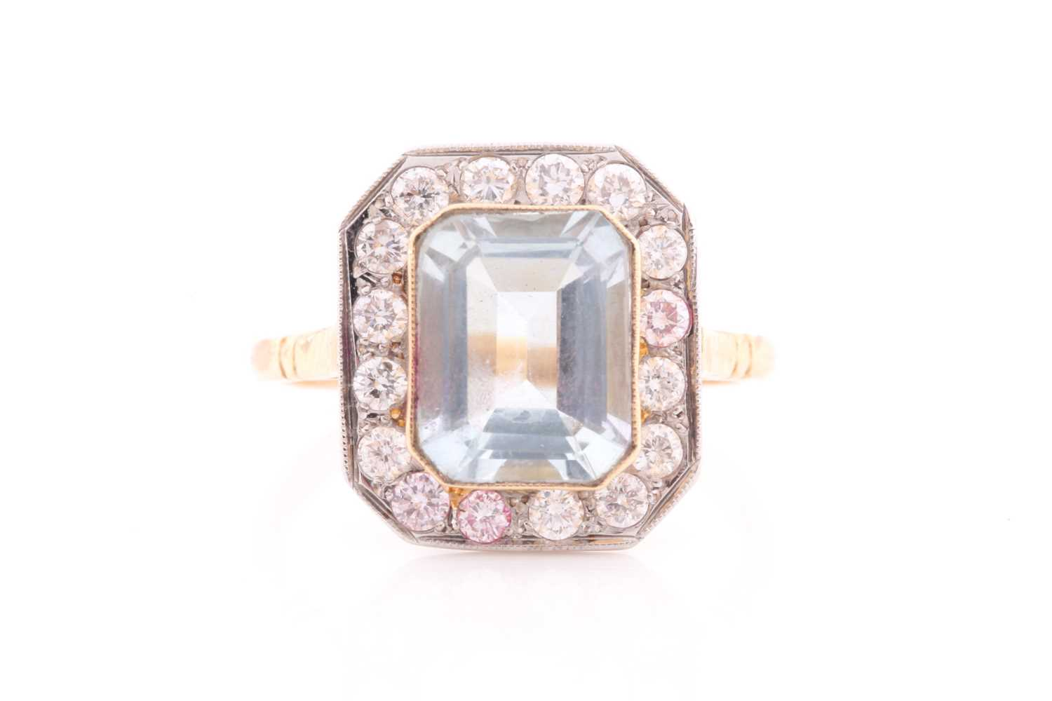 A diamond and aquamarine ring, set with an emerald-cut aquamarine of approximately 2.30 carats,
