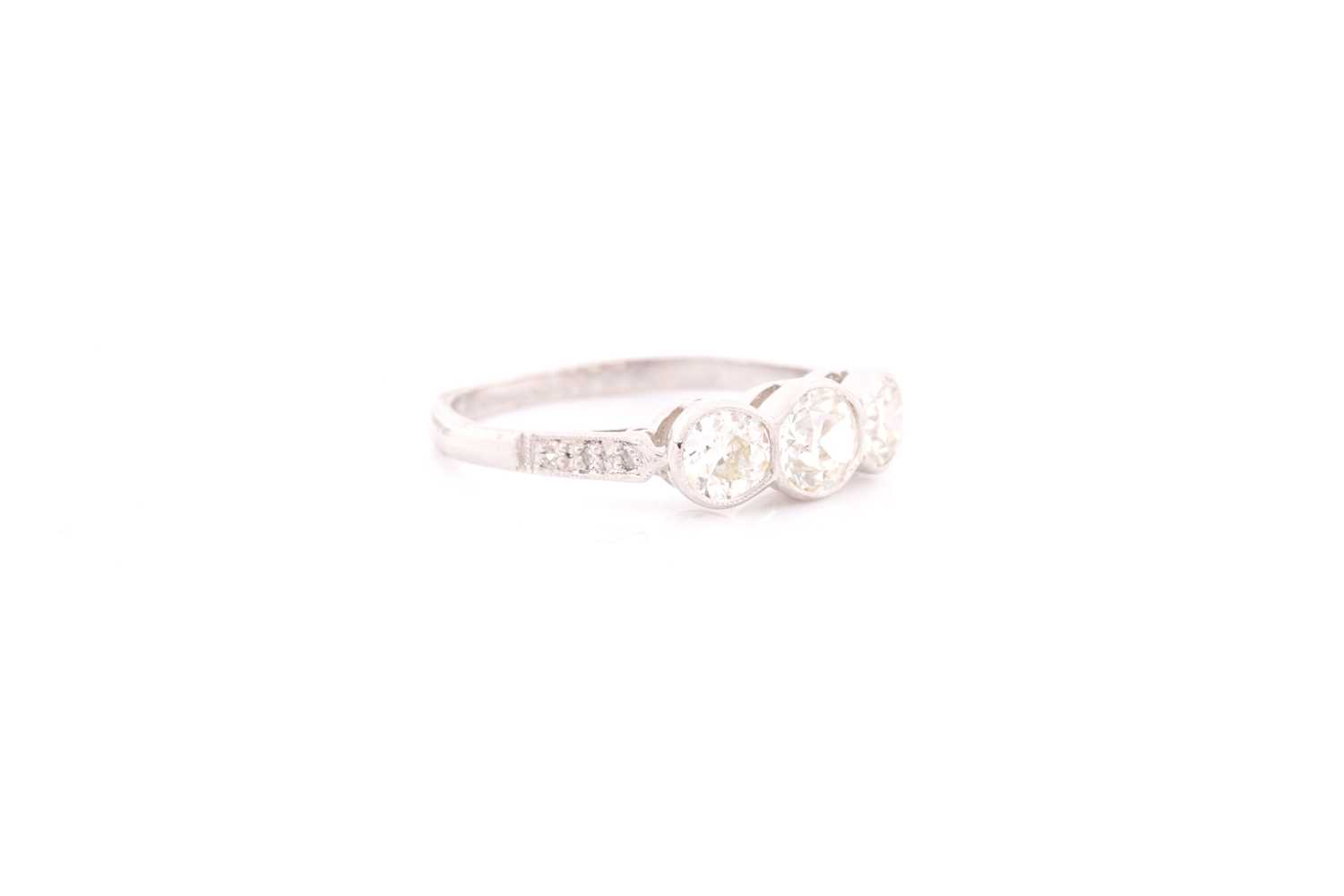 A platinum and diamond ring, collet-set with three old round-cut diamonds of approximately 1.35 - Image 4 of 4
