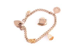 A 9 carat gold curb pattern charm bracelet, with padlock clasp and suspending four charms,