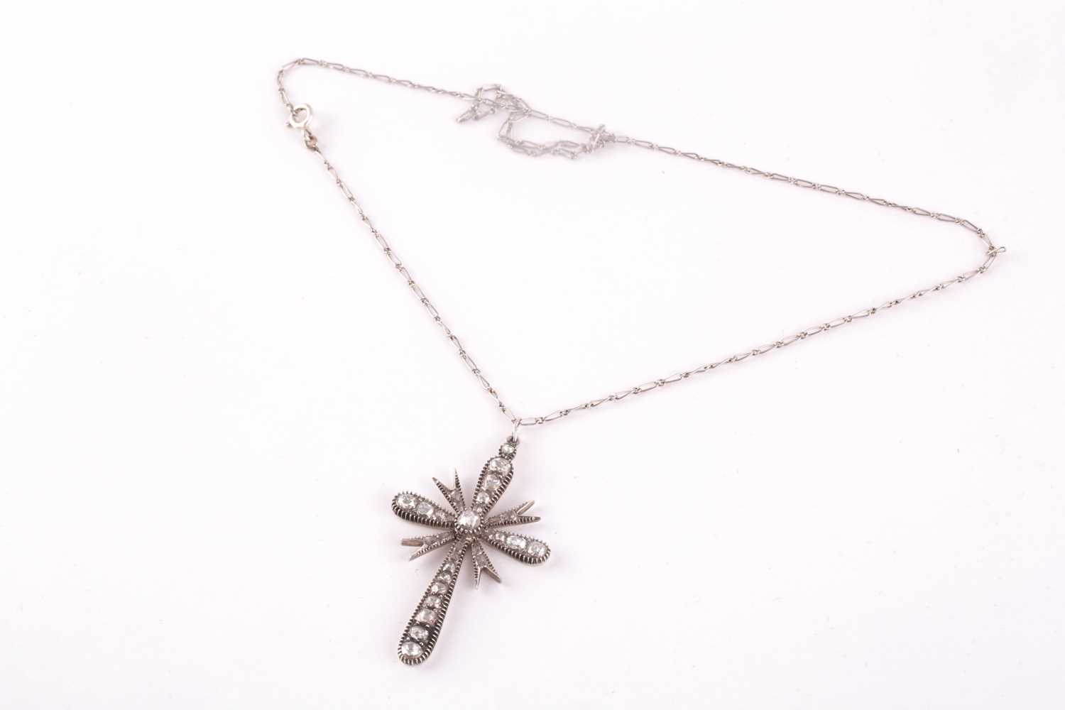A white metal and diamond cross pendant, set with mixed rose-cut diamonds, 4.5 x 2.9 cm, unmarked, - Image 2 of 4