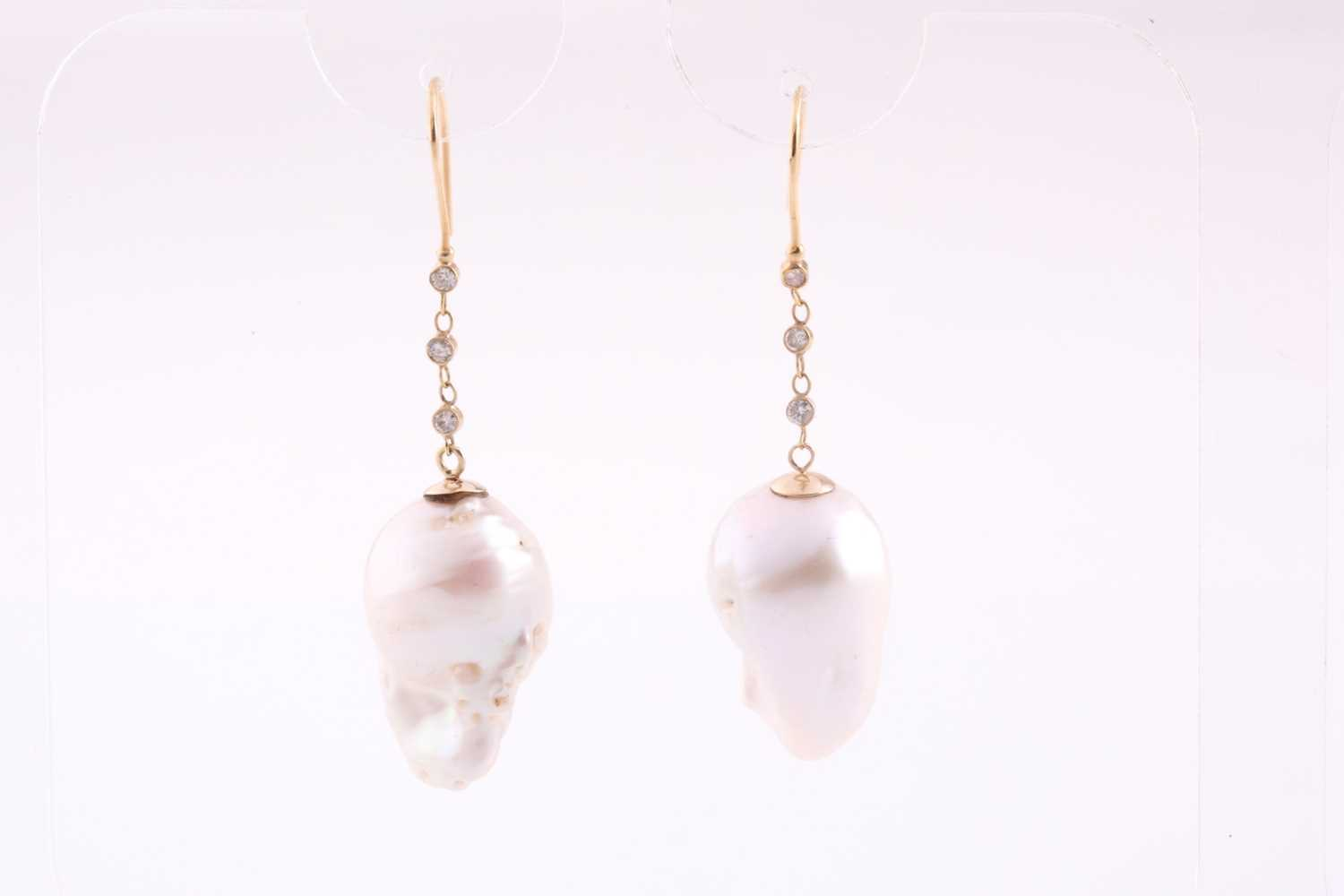 A pair of Baroque pearl and diamond drop earrings, the pearls drill mounted beneath a chain of three - Image 2 of 2