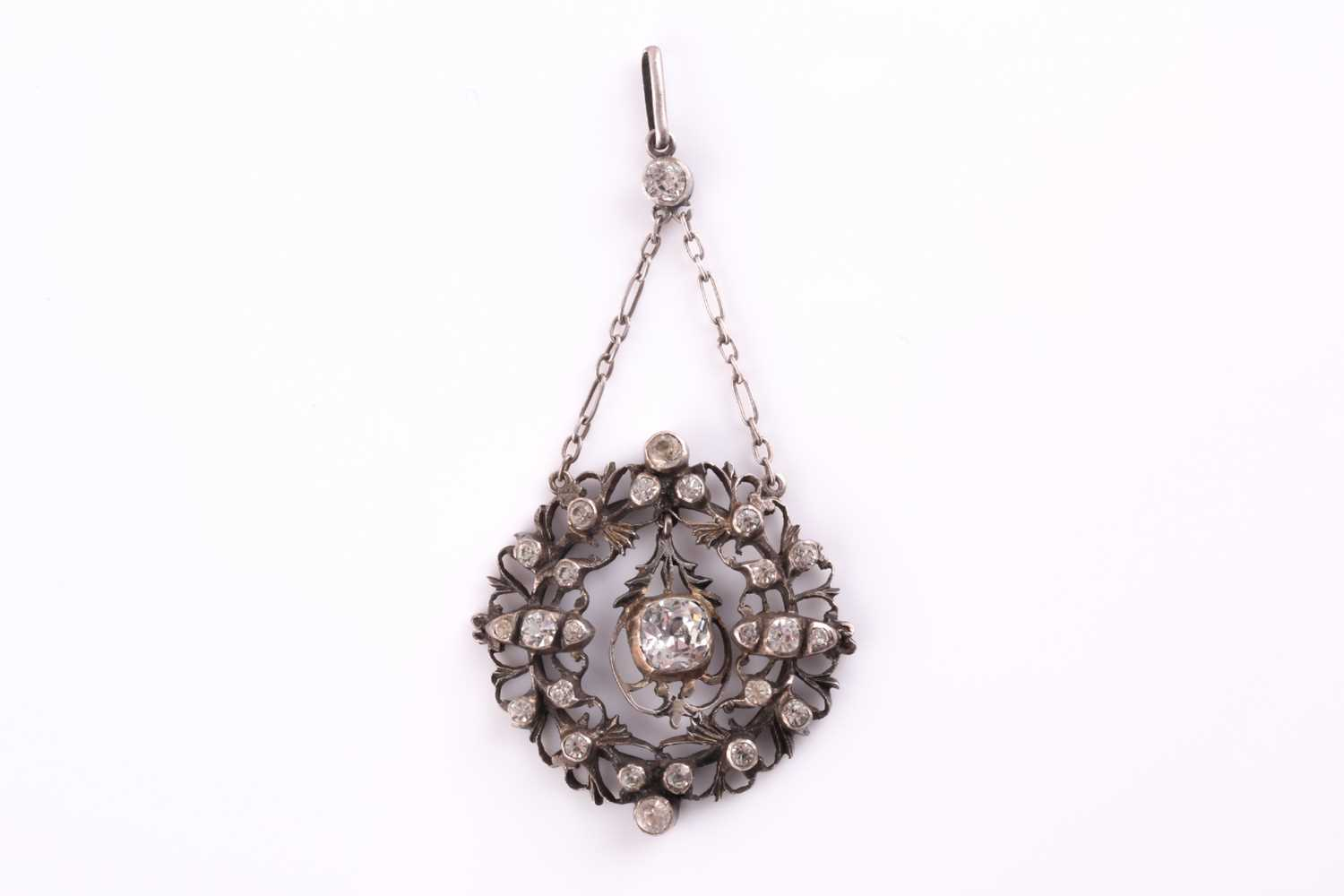 A 19th century white metal and paste pendant, centered with a cushion-cut paste pendant, the - Image 3 of 3