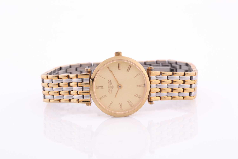 Longines. A ladies gilt metal 'La Grande Classique de Longines' wristwatch, gilt baton dial on