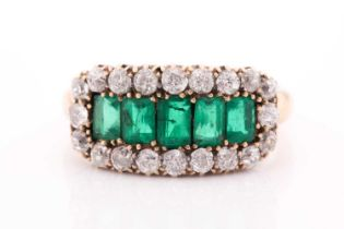 An emerald and diamond three row ring, set with a central line of slightly graduated emerald-cut