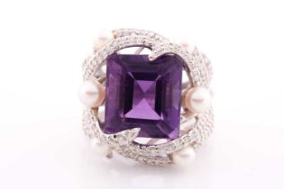 An impressive diamond and amethyst cocktail ring, centred with a mixed square-cut amethyst,