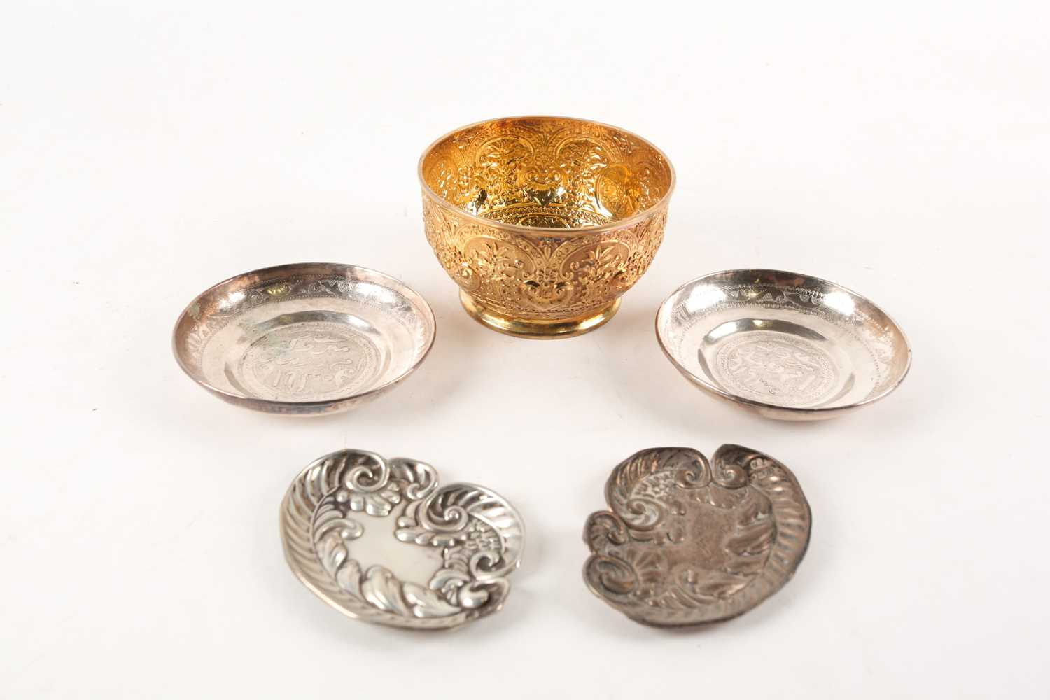 A Victorian silver gilt bowl, London 1880 by Holland, Son & Slater, with heavily embossed foliate