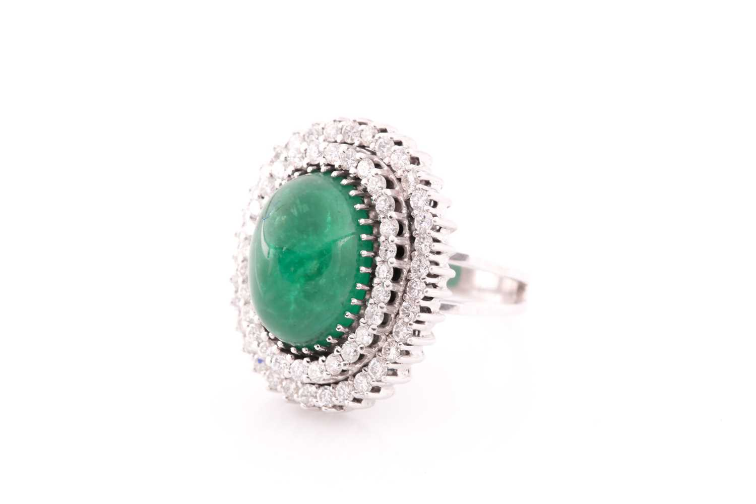A diamond and emerald cocktail ring, circa 1960s, centred with an oval cabochon emerald, measuring - Image 2 of 6