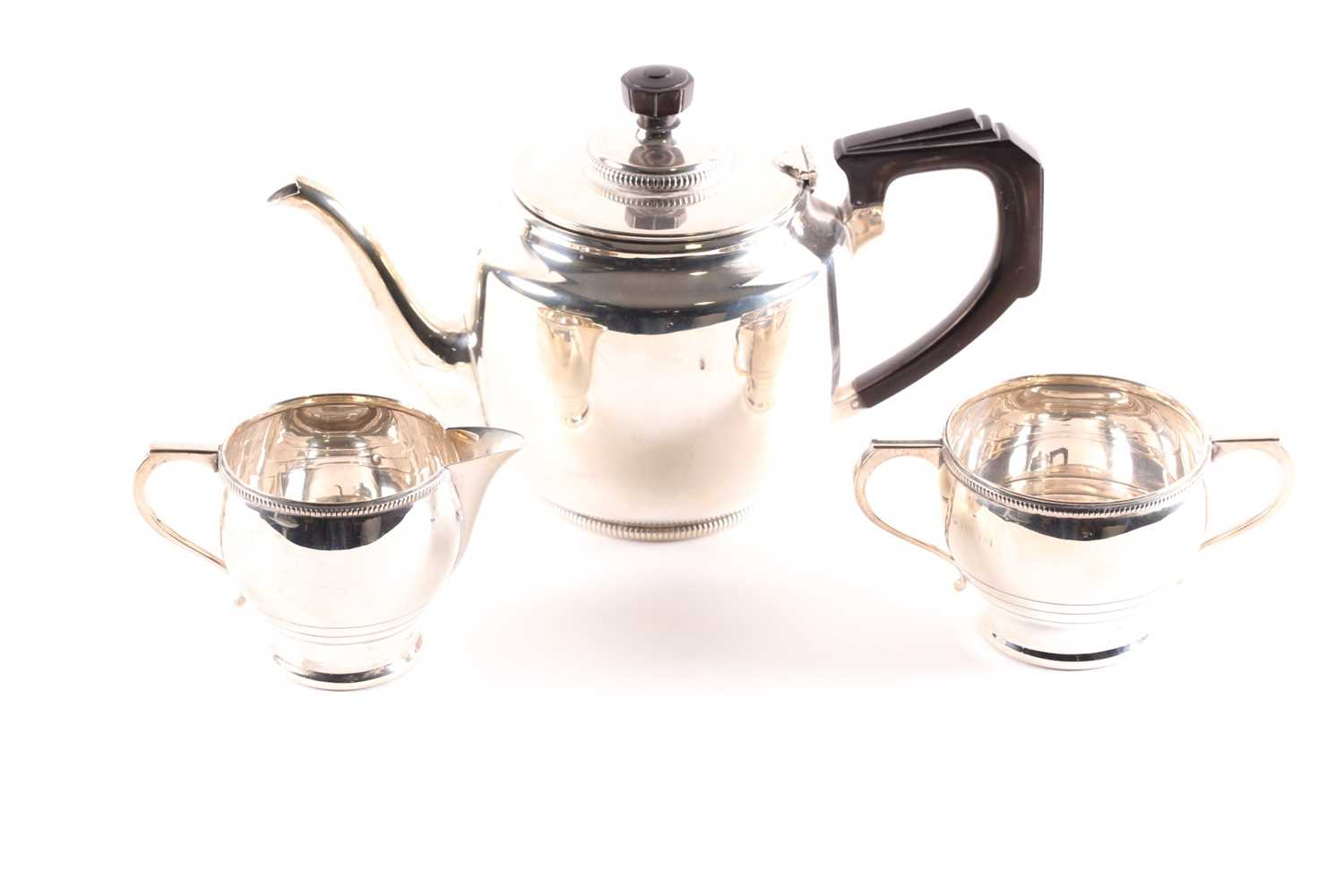 A George V three-piece silver tea set, Birmingham 1930s (mixed dates), by William Neale & Son, in