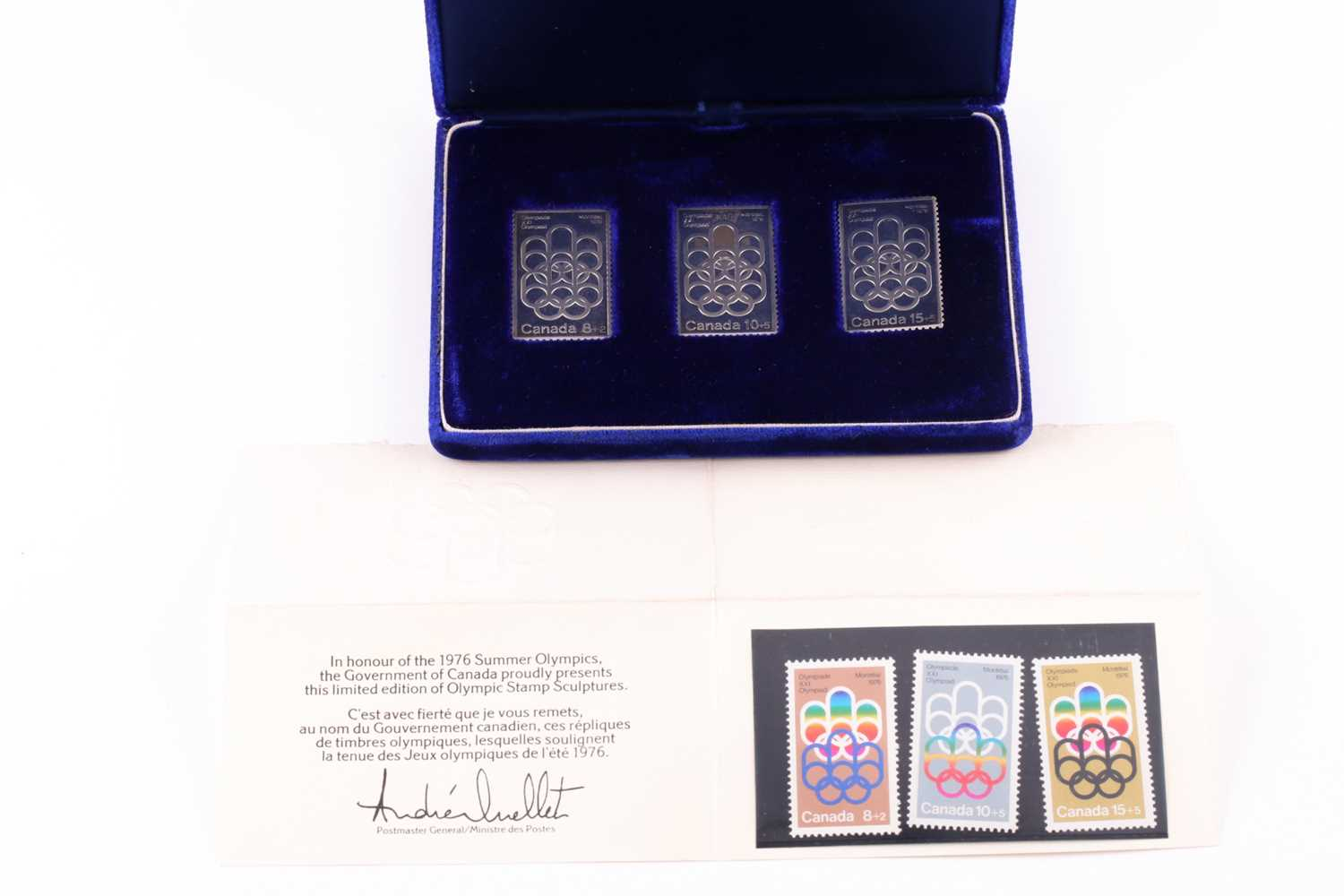 A cased set of three silver ingots, designed as stamps, in honour of the 1976 Summer Olympics,
