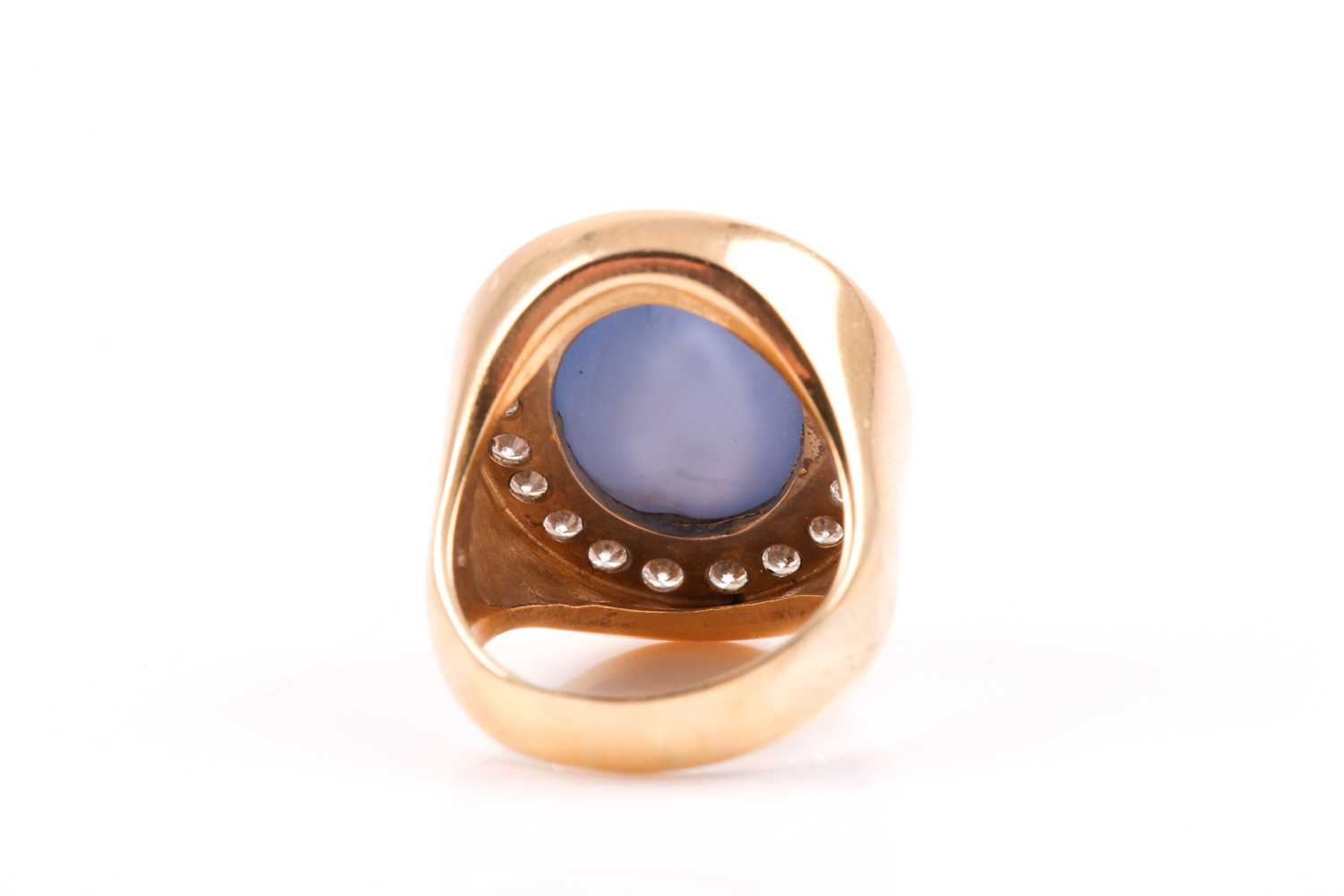 An 18ct yellow gold, diamond, and star sapphire cocktail ring, set with a domed cabochon sapphire, - Image 2 of 9