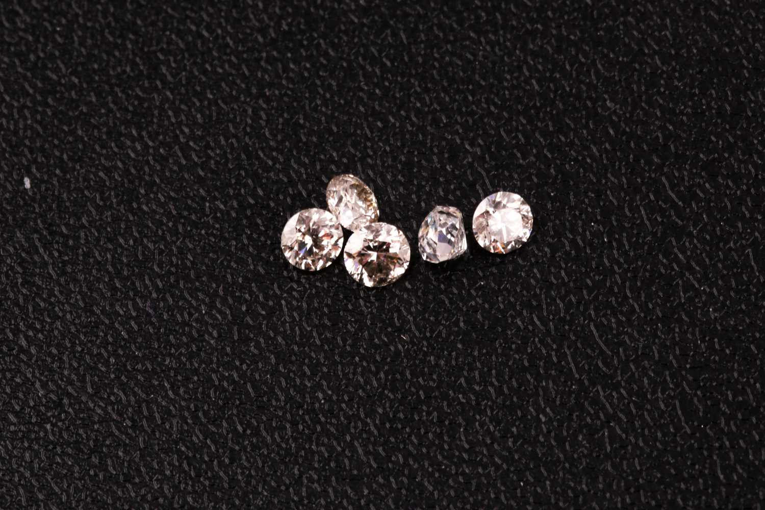 A group of five round brilliant-cut diamonds, showing slight colour, approximately 1.12 carats - Image 2 of 3