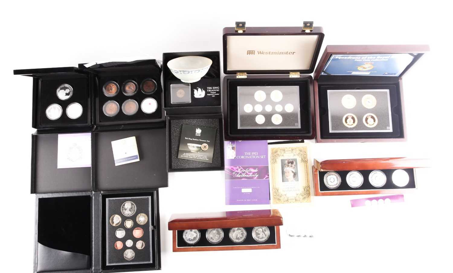 Eight boxed sets of commemorative coins, comprising: 'Squadrons of the Royal Air Force' four-coin