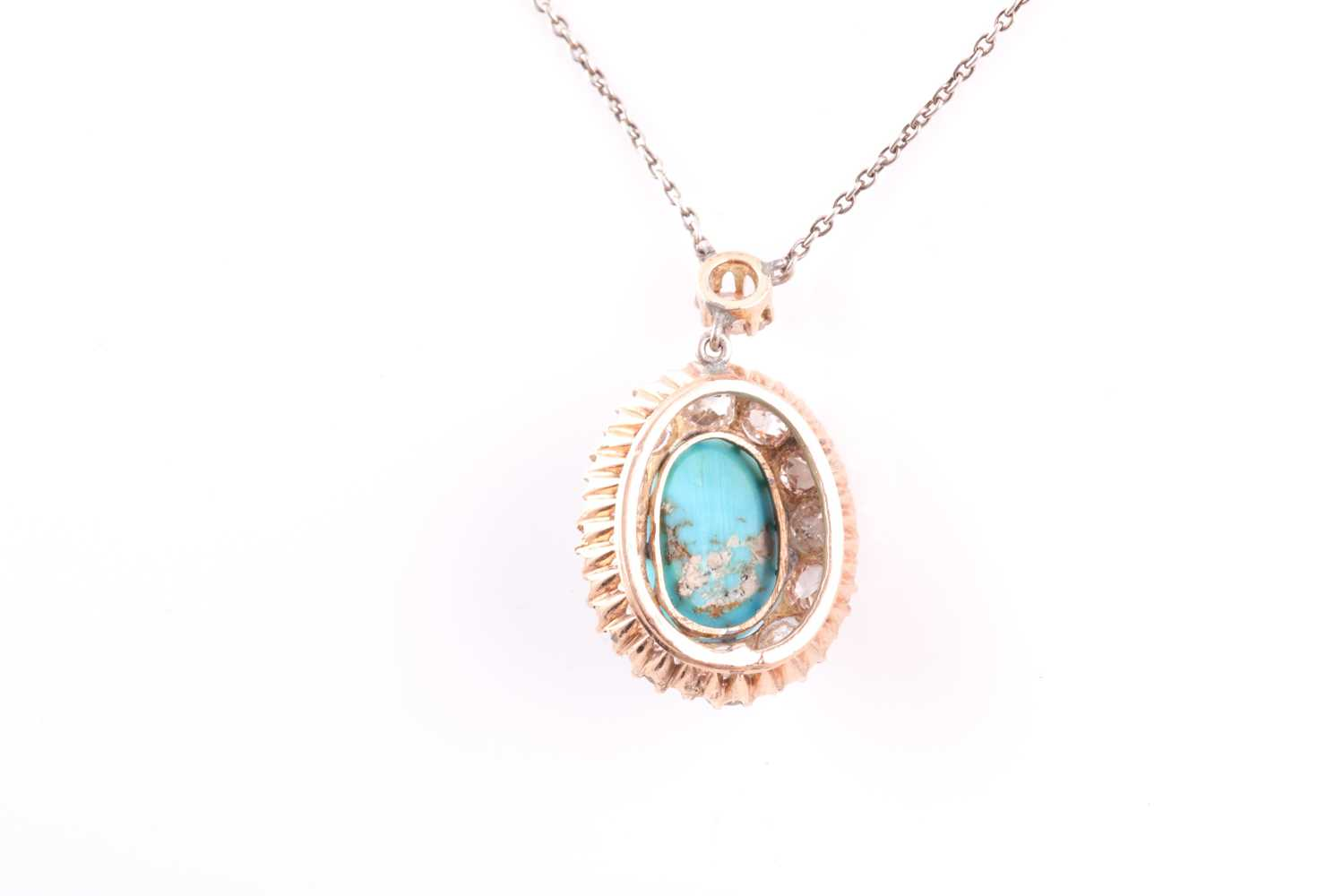 A diamond and turquoise cluster pendant, set with an oval turquoise plaque, surrounded with old- - Image 2 of 4