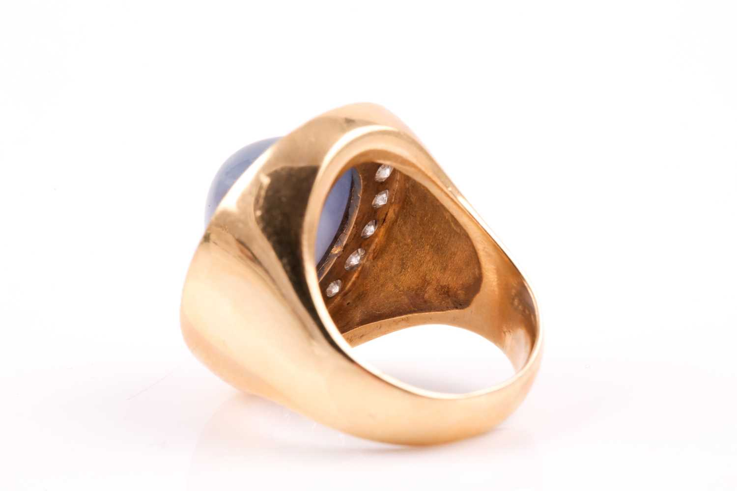 An 18ct yellow gold, diamond, and star sapphire cocktail ring, set with a domed cabochon sapphire, - Image 6 of 9