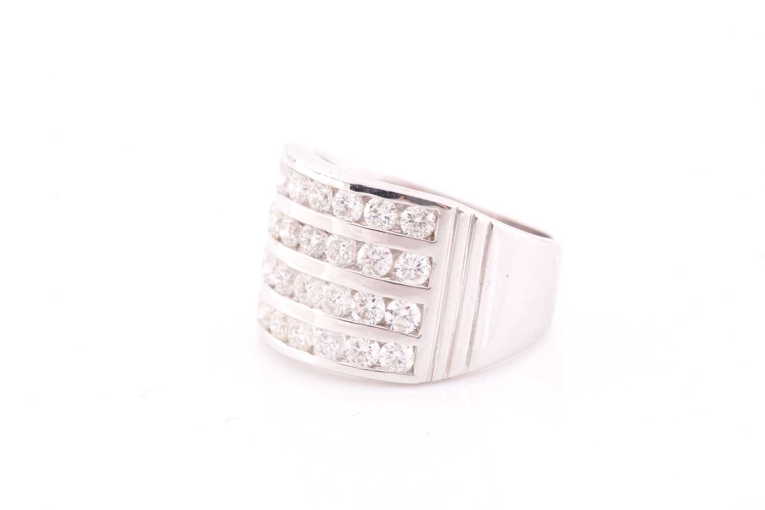 A diamond band ring, channel-set with four rows of round brilliant-cut diamonds of approximately 2. - Image 3 of 4