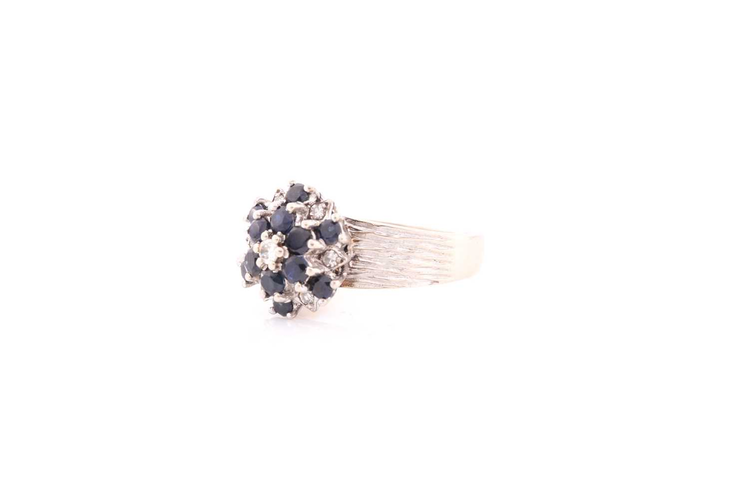 An 18ct white gold, diamond, and sapphire cluster ring, set with a cluster of round-cut sapphires - Image 3 of 4