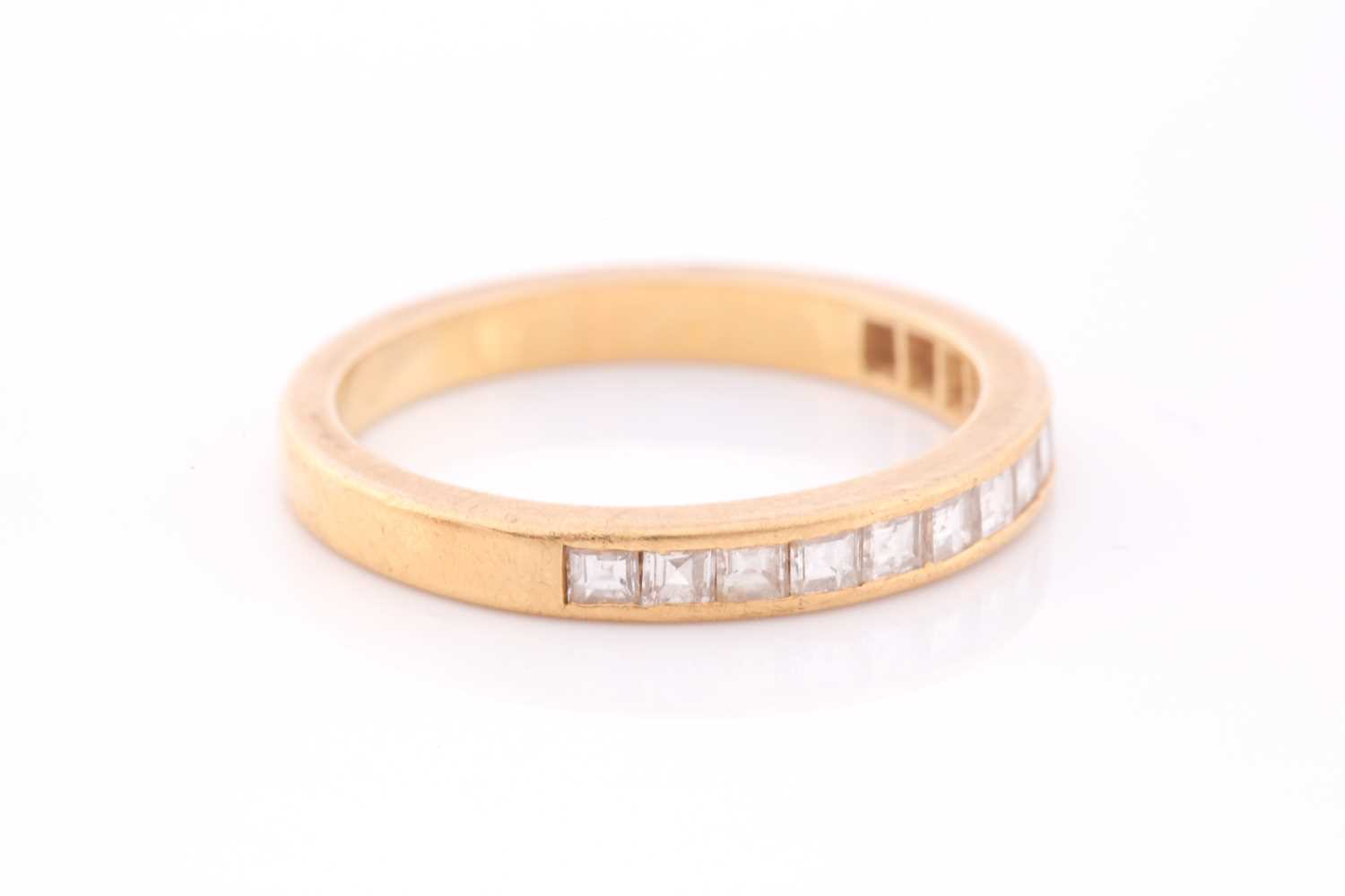 An 18ct yellow gold and diamond half-eternity ring the band calibre set with fourteen princess cut - Image 3 of 4