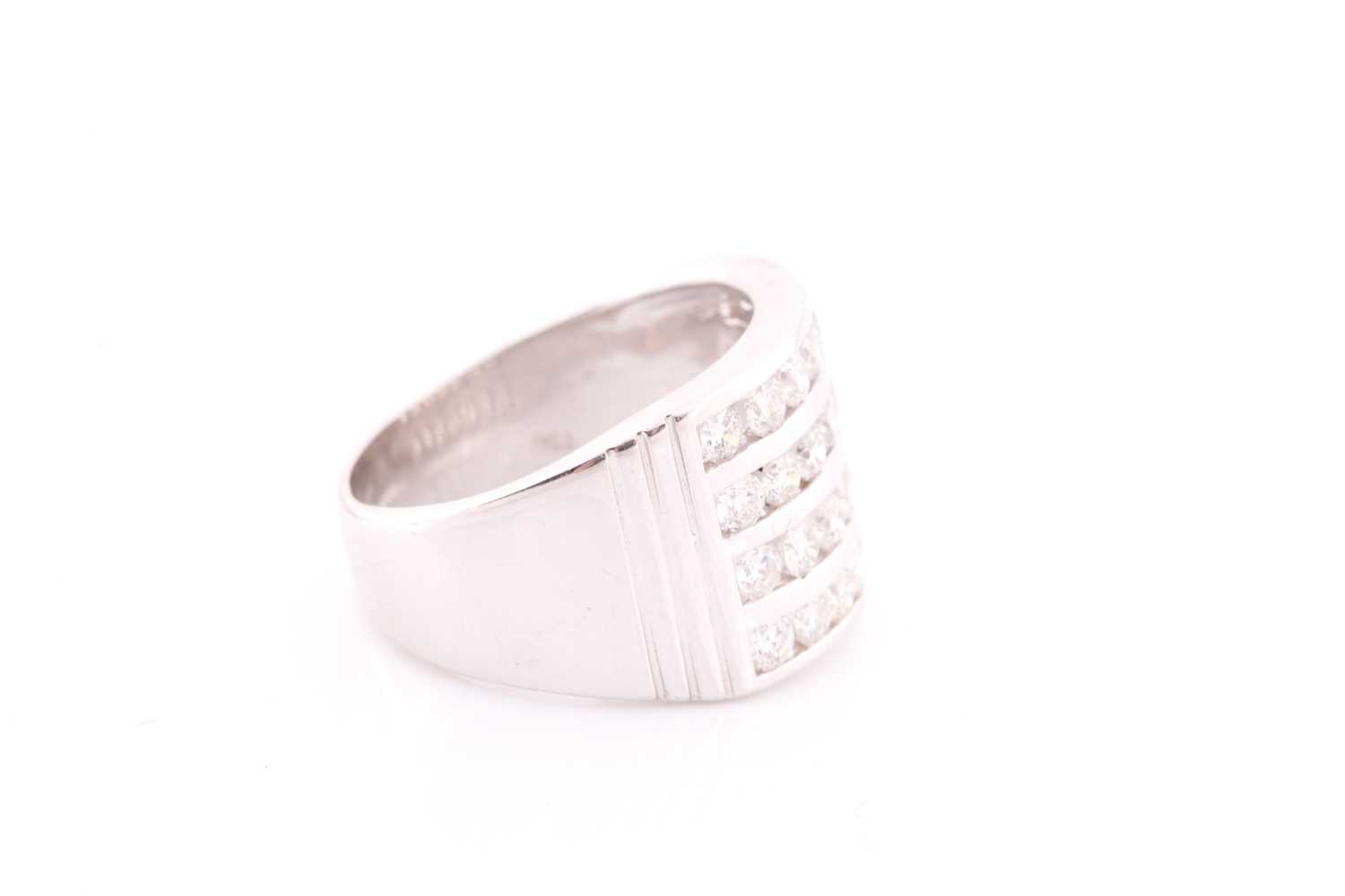 A diamond band ring, channel-set with four rows of round brilliant-cut diamonds of approximately 2. - Image 4 of 4