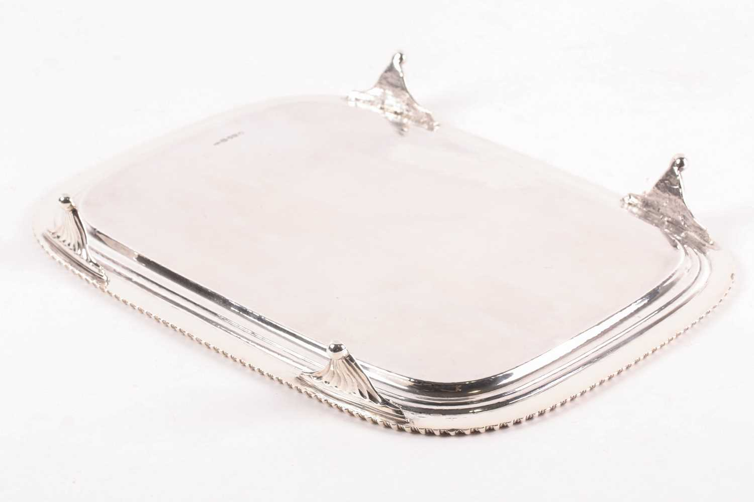 A George III rectangular silver salver. London 1812 William Bennet, with raised gadrooned border - Image 3 of 4