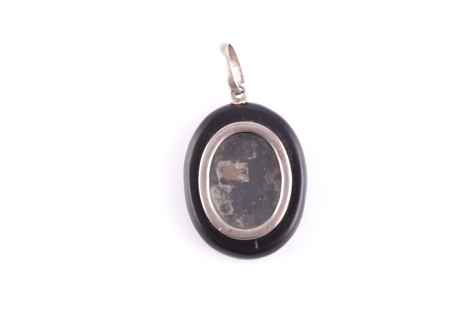 A silver and black hardstone pendant locket, the back inset with a pietra dura design of a flower - Image 2 of 2