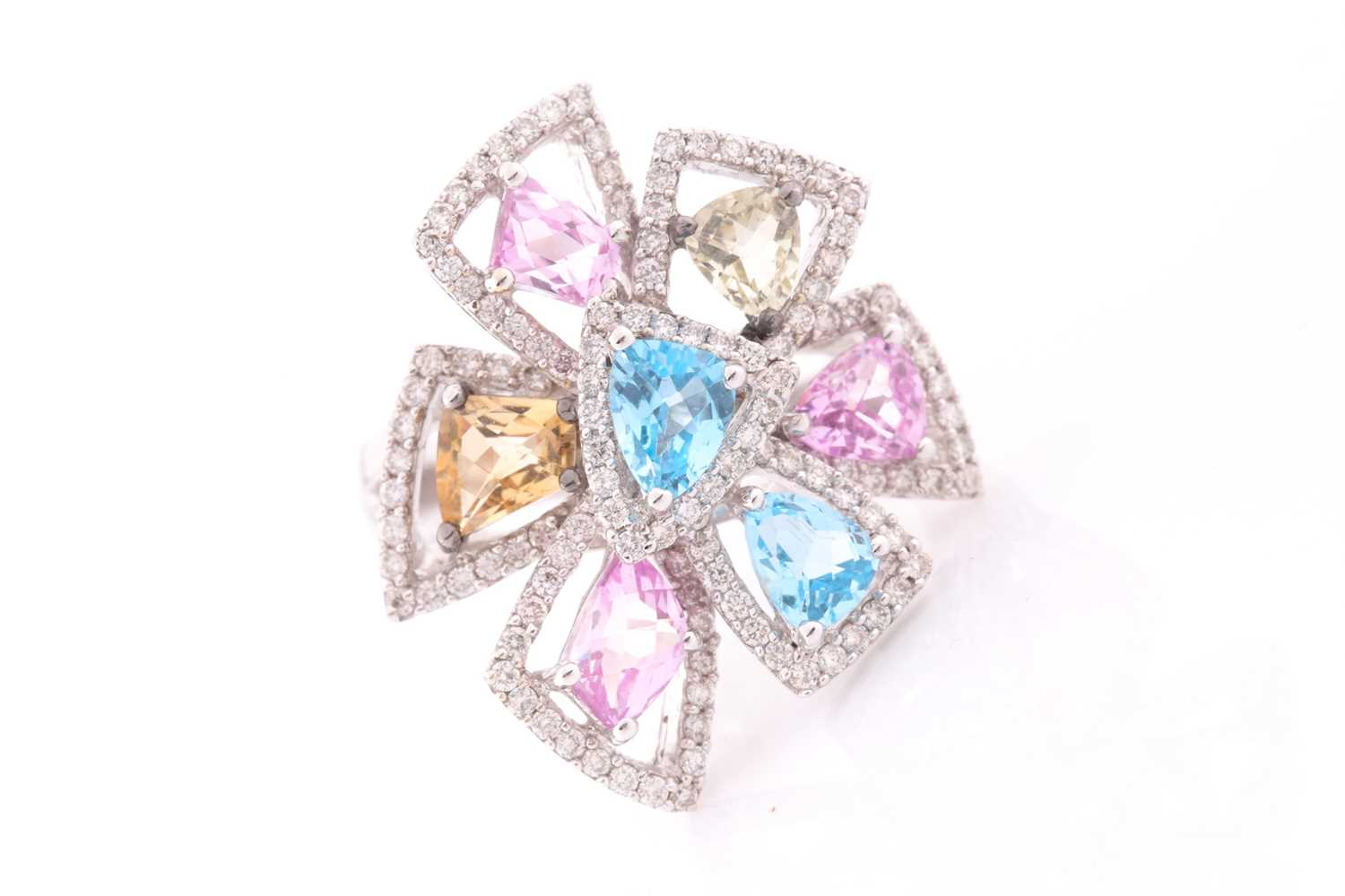 An 18ct white gold, diamond, and multi-coloured topaz ring of geometric floral form, the openwork